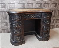 Lot 1631-A VICTORIAN CARVED OAK KNEE HOLE DESK