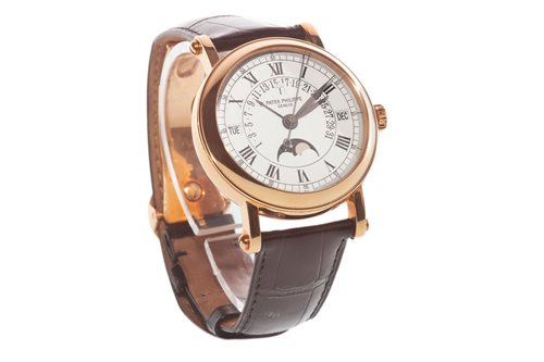 Lot 777-A GENTLEMAN'S RARE PATEK PHILIPPE 5059R WRIST WATCH