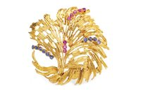 Lot 9-AN EIGHTEEN CARAT GOLD GEM SET BROOCH