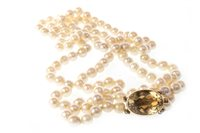 Lot 136 - A PEARL NECKLACE WITH GEM SET CLASP