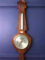 Lot 29-AN EDWARDIAN WHEEL BAROMETER AND THERMOMETER