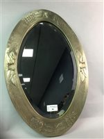Lot 30-AN OVAL BEVELLED MIRROR