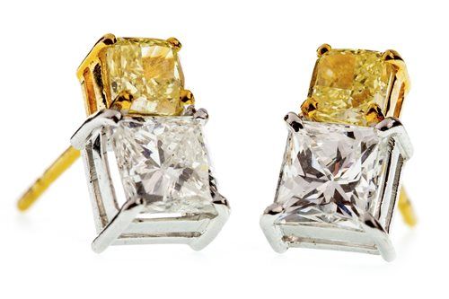 Lot 4-A PAIR OF YELLOW AND WHITE DIAMOND EARRINGS