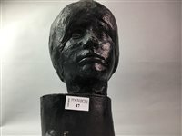 Lot 47-A PLASTER HEAD OF A YOUNG WOMAN