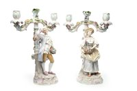 Lot 1239 - A PAIR OF GERMAN PORCELAIN FIGURAL CANDELABRA IN THE STYLE OF MEISSEN