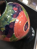 Lot 1241 - A PAIR OF MOORCROFT VASES