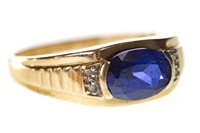 Lot 79-A GENTLEMAN'S BLUE GEM SET RING
