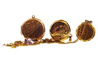 Lot 42-TWO GOLD LOCKETS AND THREE CHAINS