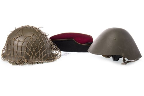 Lot 1766-A POST WAR AMERICAN STYLE STEEL HELMET, AN EAST GERMAN HELMET AND ANOTHER