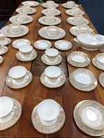 Lot 44-ROYAL DOULTON WHITE AND GOLD 'SOVEREIGN' DINNER SERVICE