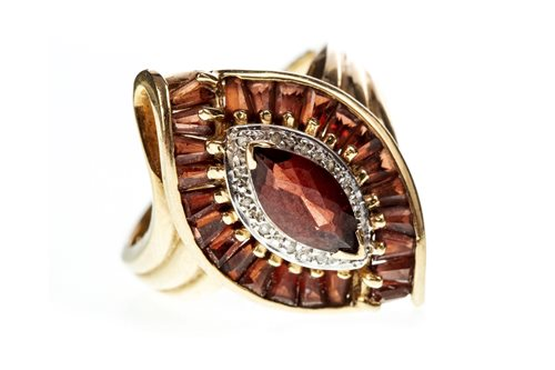 Lot 21-A RED GEM SET RING