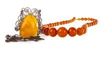 Lot 29-AN AMBER BEAD NECKLACE AND AN AMBER SET NECKLET