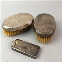 Lot 6-A PAIR OF GEORGE V SILVER BACKED CLOTHES BRUSHES AND A SILVER LID
