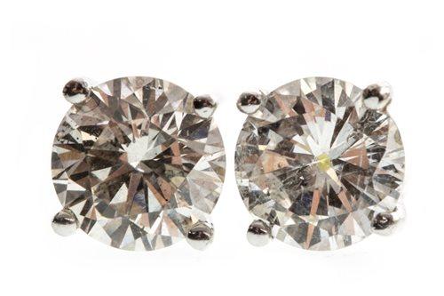 Lot 4-A PAIR OF DIAMOND STUD EARRINGS