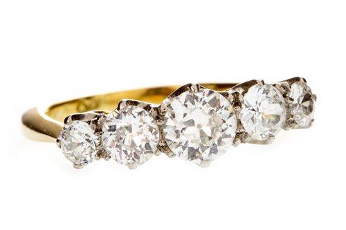Lot 1-A DIAMOND FIVE STONE RING