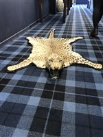 Lot 824-A LATE 19TH/EARLY 20TH CENTURY LEOPARD SKIN RUG