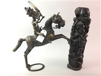 Lot 27-A LOT OF THREE AFRICAN FIGURAL SCULPTURES