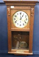 Lot 29-AN OAK CASED WALL CLOCK