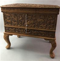 Lot 2-AN ANGLO-INDIAN CARVED TEAK SEWING BOX AND A CARVED WOOD BOX