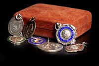 Lot 1916-A LOT OF EARLY 20TH CENTURY SILVER FOOTBALL MEDALS