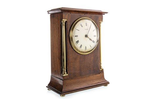 Lot 1424 - A VICTORIAN MAHOGANY MANTEL CLOCK