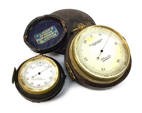 Lot 1429 - A 19TH CENTURY TRAVELLING SURVEYING ANEROID BAROMETER AND A POCKET BAROMETER