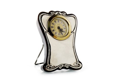 Lot 1431 - A GEORGE V SILVER CASED BEDROOM TIMEPIECE