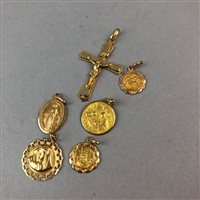 Lot 39-AN EIGHTEEN CARAT GOLD CRUCIFIX AND OTHER GOLD MEDALLIONS