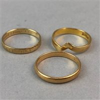 Lot 40-A NINE CARAT GOLD BAND AND TWO OTHER RINGS