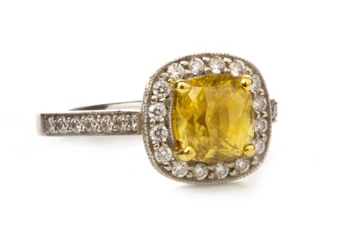 Lot 143-A YELLOW SAPPHIRE AND DIAMOND RING