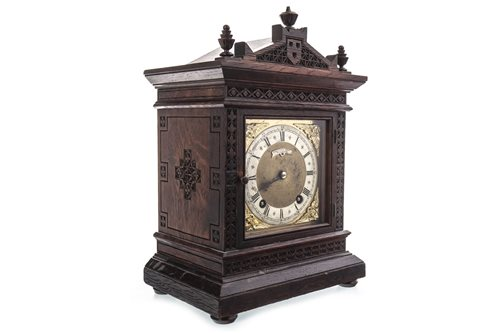 Lot 1439 - A 19TH CENTURY OAK MANTEL CLOCK BY SHEPPARD BROS OF WALSALL