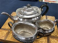 Lot 45-A SILVER PLATED THREE PIECE TEA SERVICE, PAIR OF SALT DISHES AND BRASS CANDLESTICKS