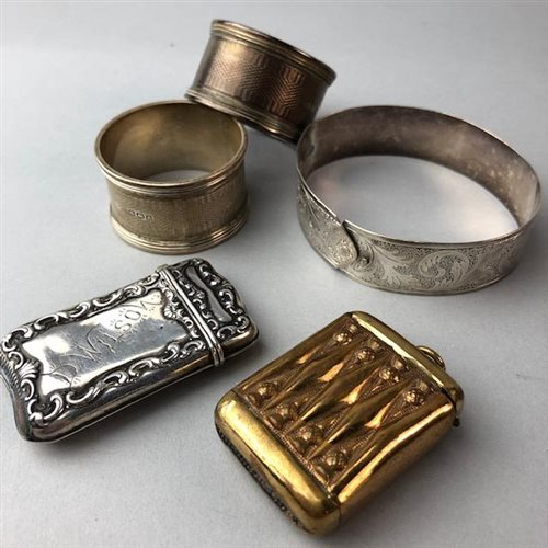 Lot 4-A PAIR OF SILVER NAPKIN RINGS, TWO VESTA CASES AND A SILVER BANGLE