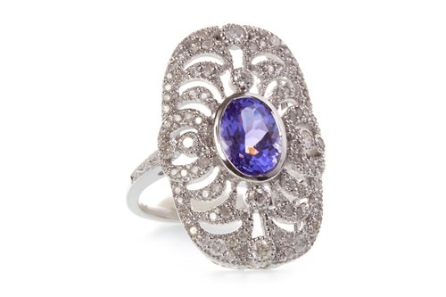 Lot 24-A TANZANITE AND DIAMOND RING