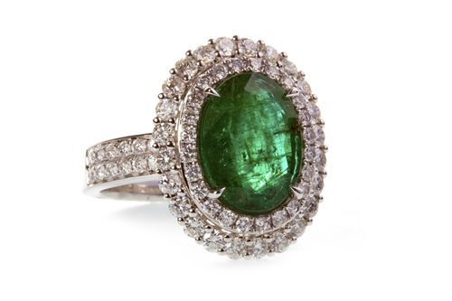 Lot 46-AN EMERALD AND DIAMOND CLUSTER RING