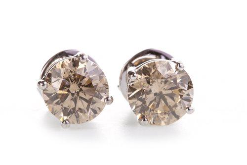 Lot 53-A PAIR OF DIAMOND STUD EARRINGS