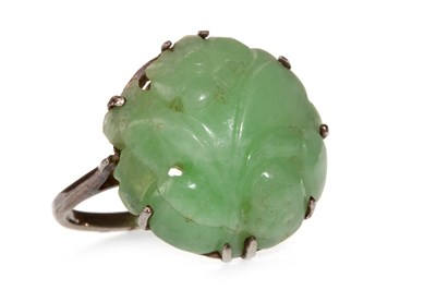 Lot 6-A CARVED GREEN HARDSTONE RING