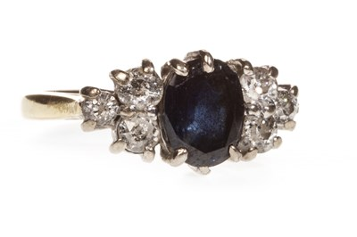 Lot 11-A DIAMOND AND BLUE GEM SET RING