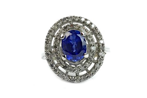Lot 3-A TANZANITE AND DIAMOND RING