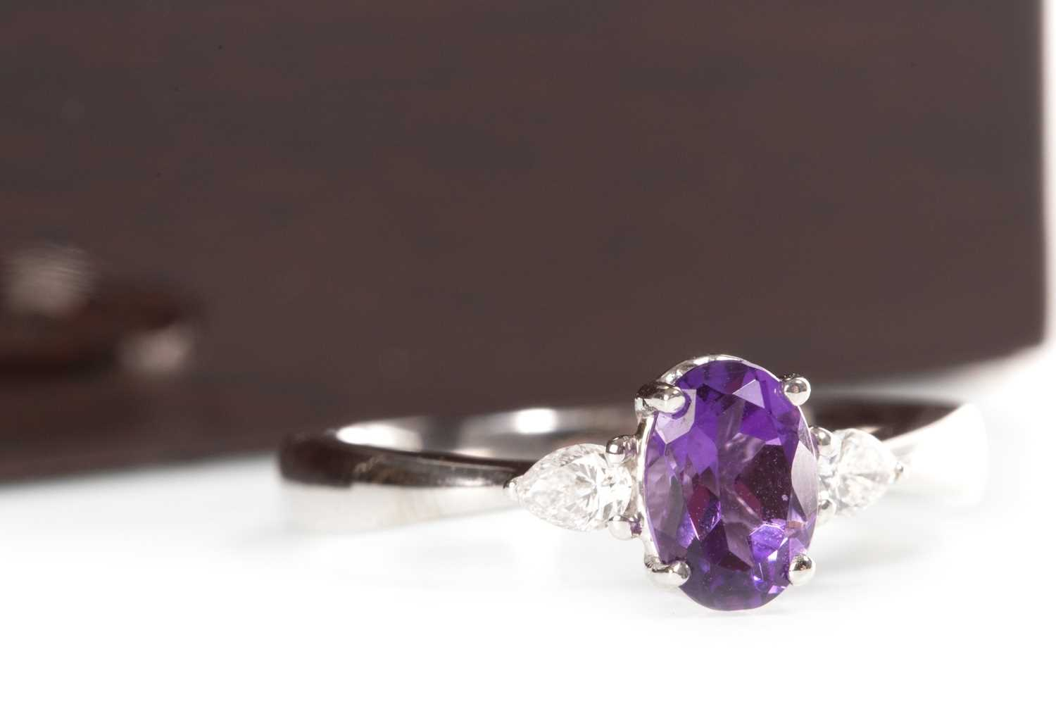 Lot 29-AN AMETHYST AND DIAMOND RING