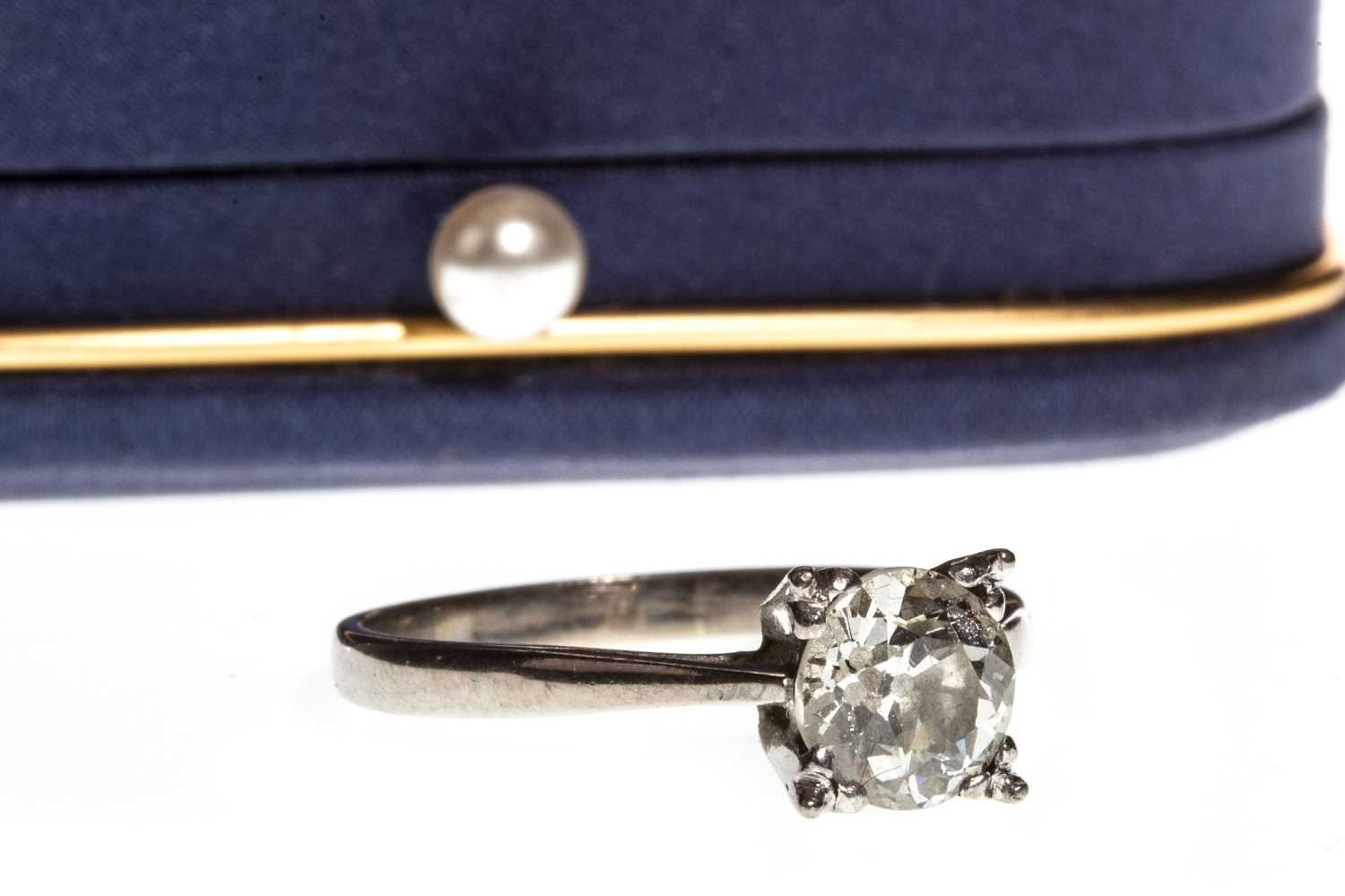 Lot 8-A DIAMOND SOLITAIRE RING
