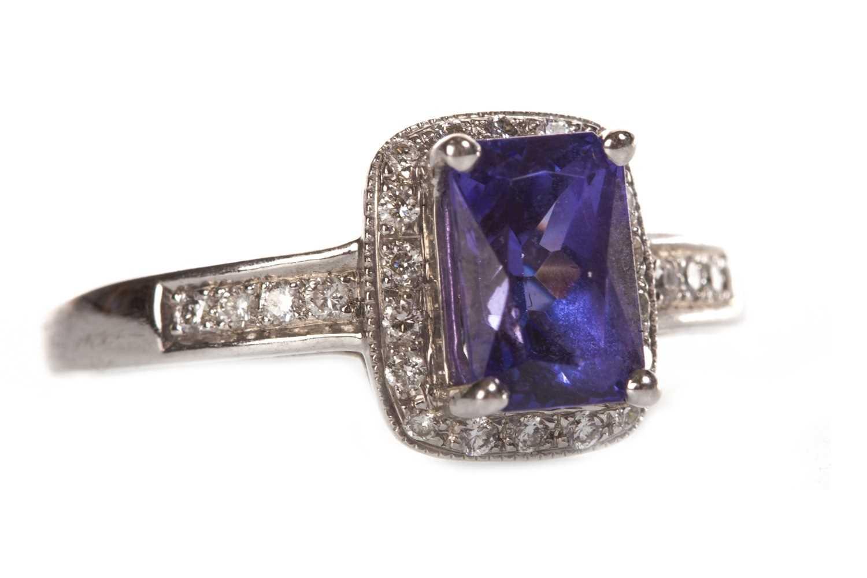 Lot 33-A TANZANITE AND DIAMOND RING