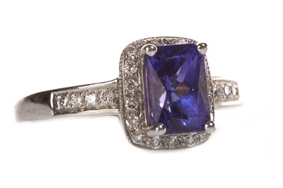 Lot 33-A TANZANITE AND DIAMOND RING