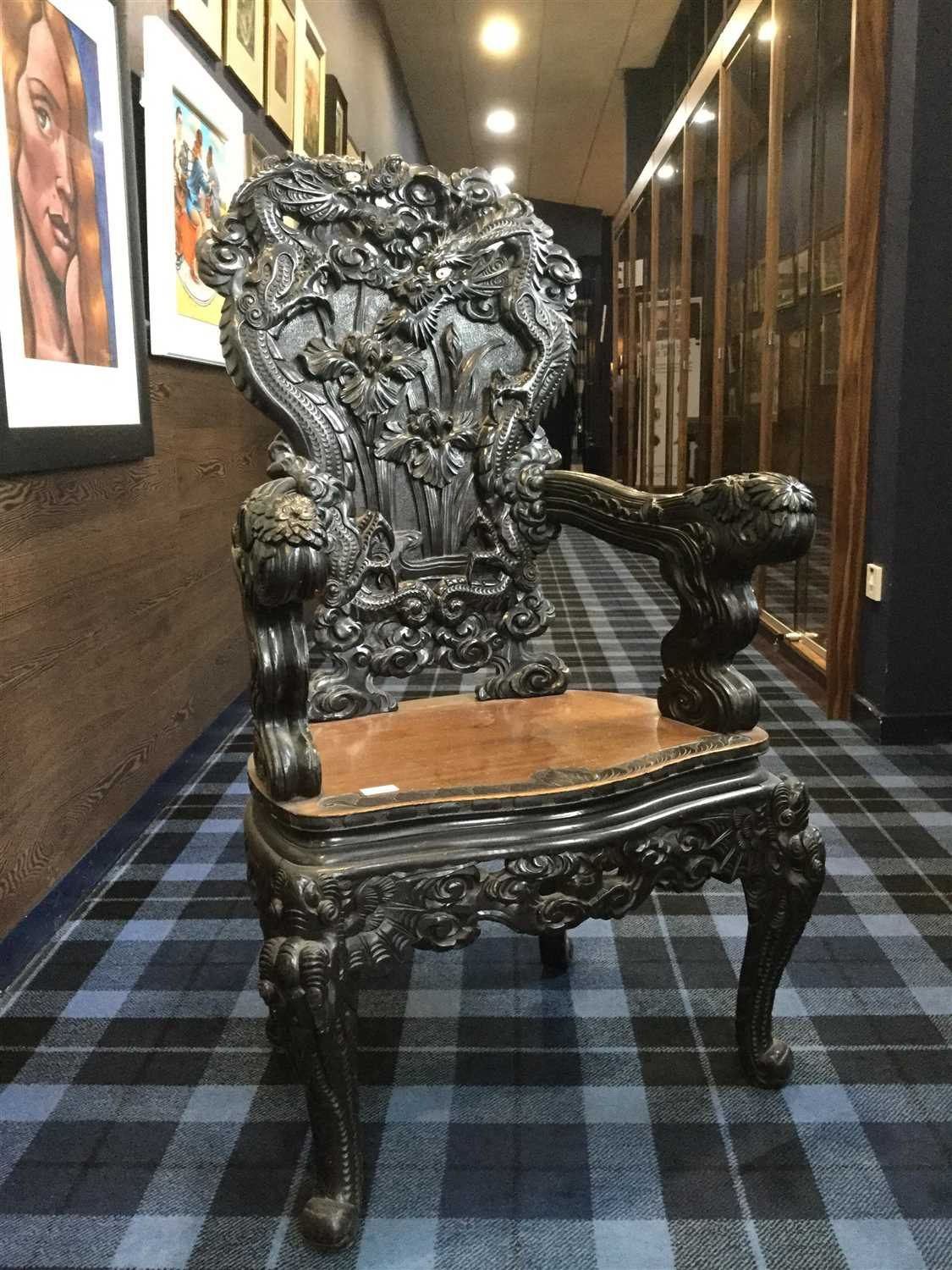 Lot 1027-A CARVED WOOD ARMCHAIR