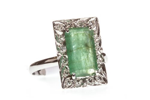 Lot 15-A MID 20TH CENTURY GREEN GEM AND DIAMOND RING