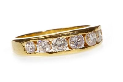 Lot 60-A DIAMOND SEVEN STONE RING