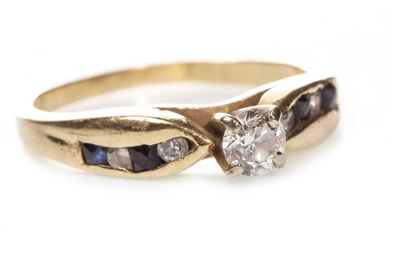 Lot 48-A DIAMOND AND GEM SET RING