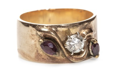 Lot 52 - A DIAMOND AND RED GEM SET BAND