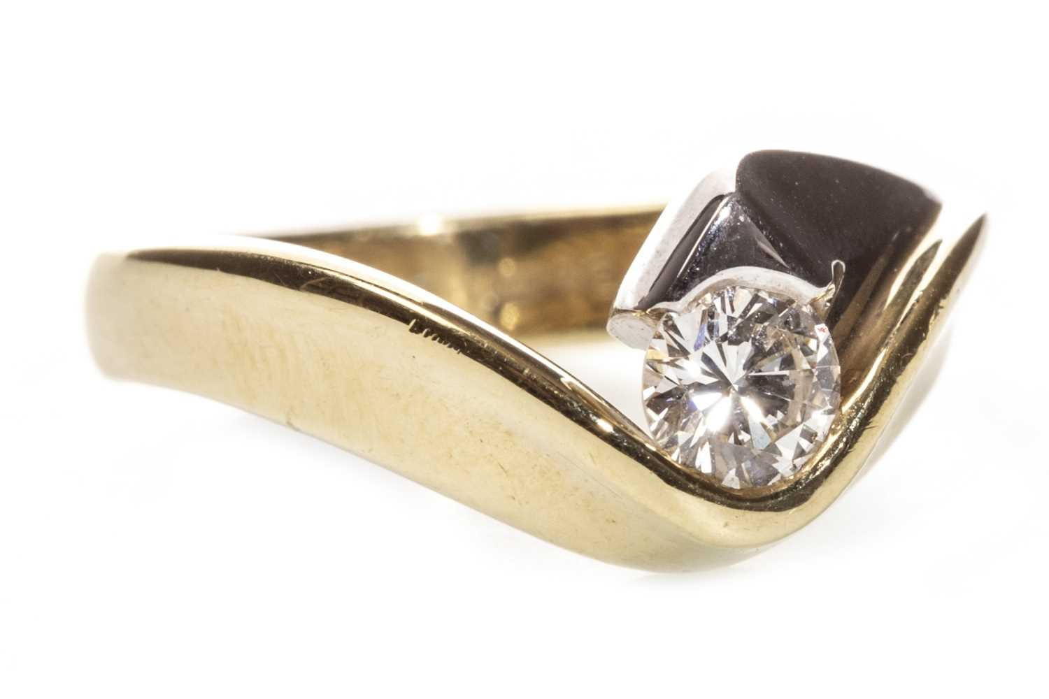 Lot 60-A DIAMOND SOLITAIRE RING