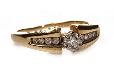 Lot 126 - A DIAMOND DRESS RING